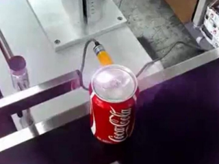 Online flying laser marking machine on coca-cola cans