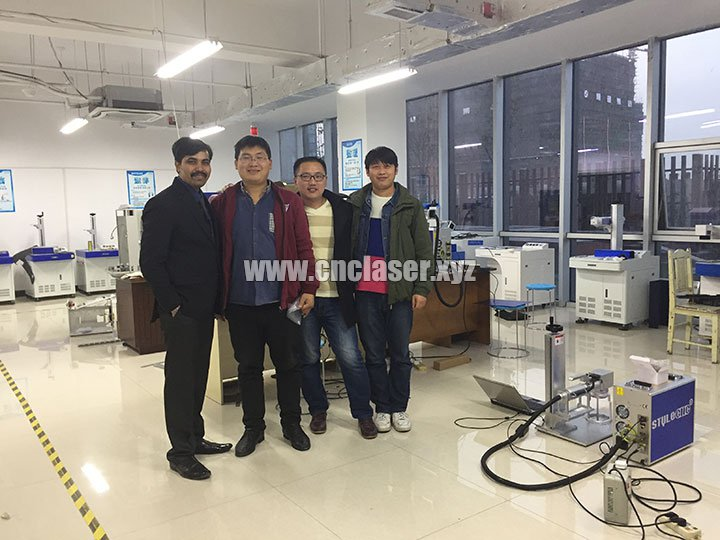 Indian customer visited our factory for checking handheld fiber laser marker